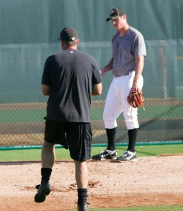 Jim Benedict working with Gerrit Cole in instructs during the 2011 season.