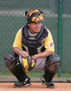 Jin-De Jhang getting ready to catch Clay Holmes' bullpen.
