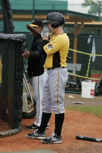 Taylor Lewis trying to keep his hands warm between time in the cages.