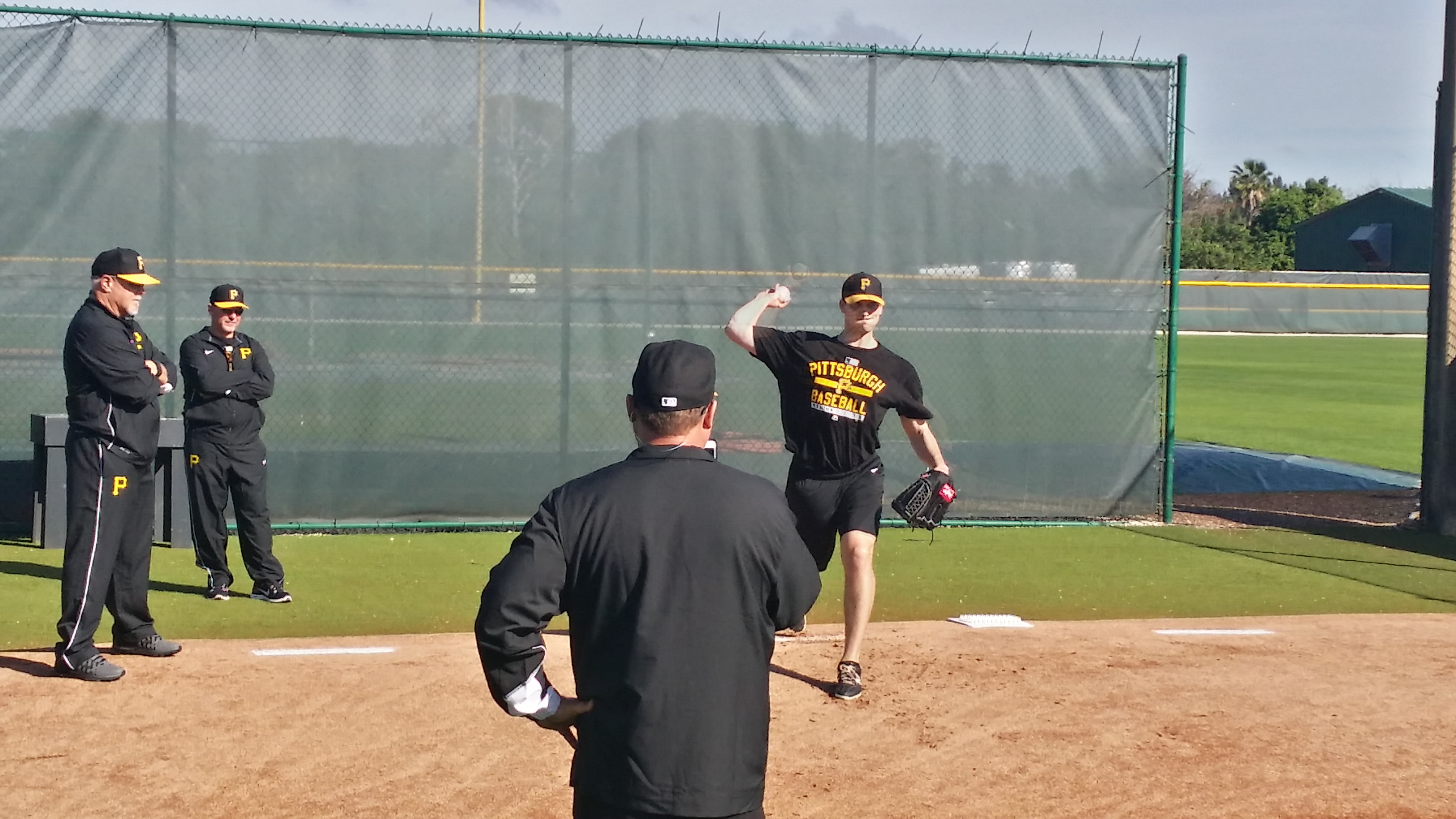 Charlie Morton throwing off the mound in front of Ray Searage, Jim Benedict, and Euclides Rojas.